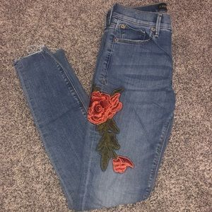 Embroidered rose Express jeans